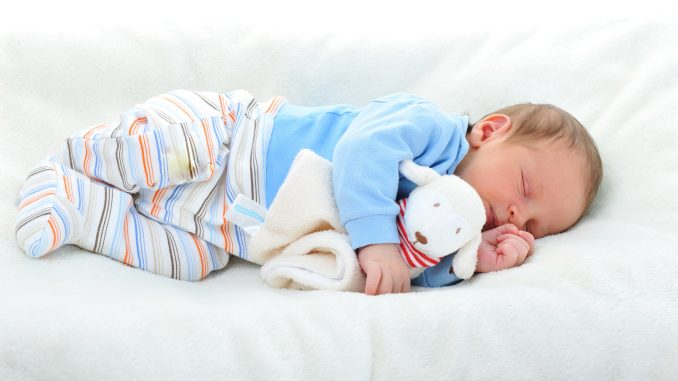 Baby Sleeping On White Blanket