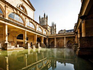 Roman Baths with Bath Abbey reflection in Bath, England