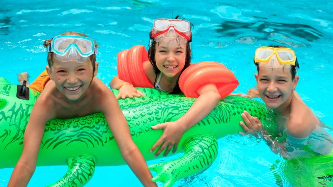 Some children swimming in a pool