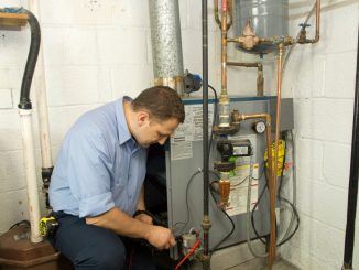 a plumber checking the gas furnace