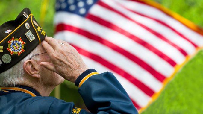 military veteran saluting the flag