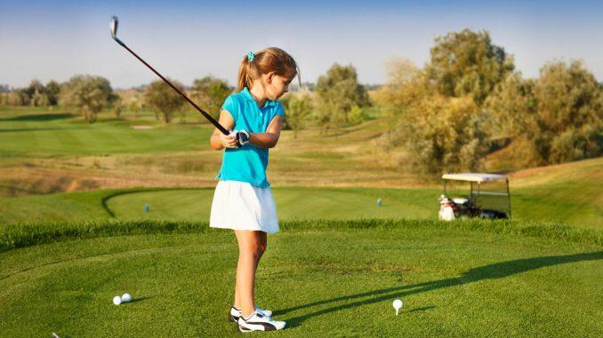 Girl playing golf