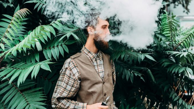 a man using an electronic cigarette