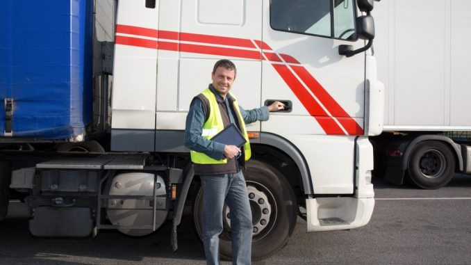 Driver Beside His Truck