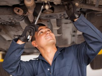 Auto Mechanic Working on a Car