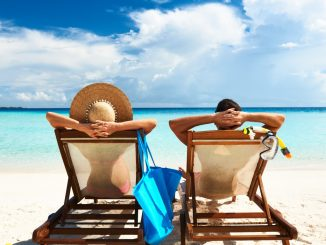 couple relaxing on a beach