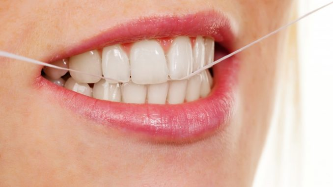 Person flossing teeth