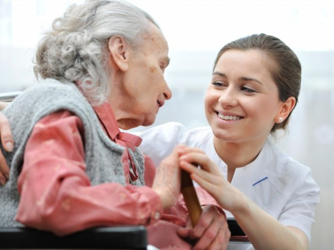 Nurse with disabled elderly woman