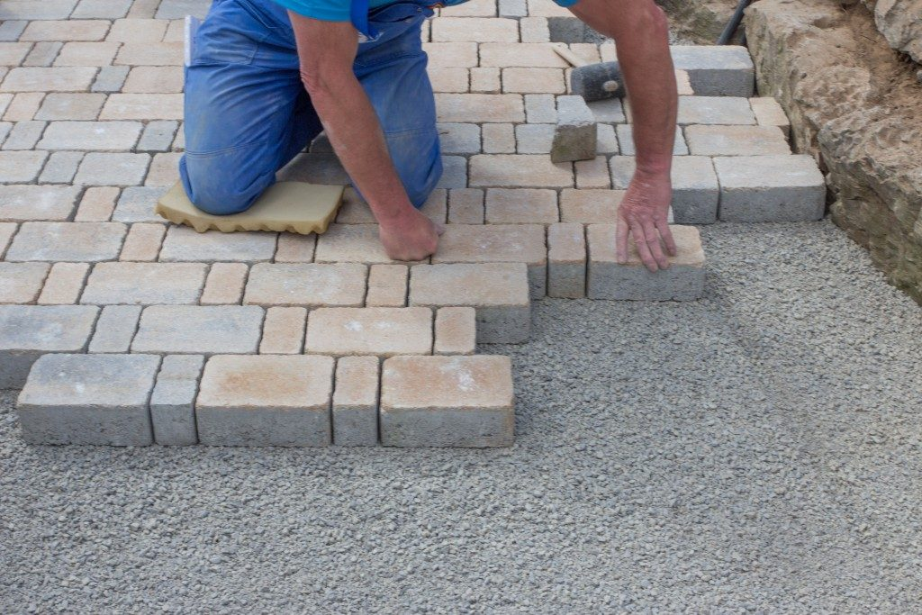 Contractor putting bricks