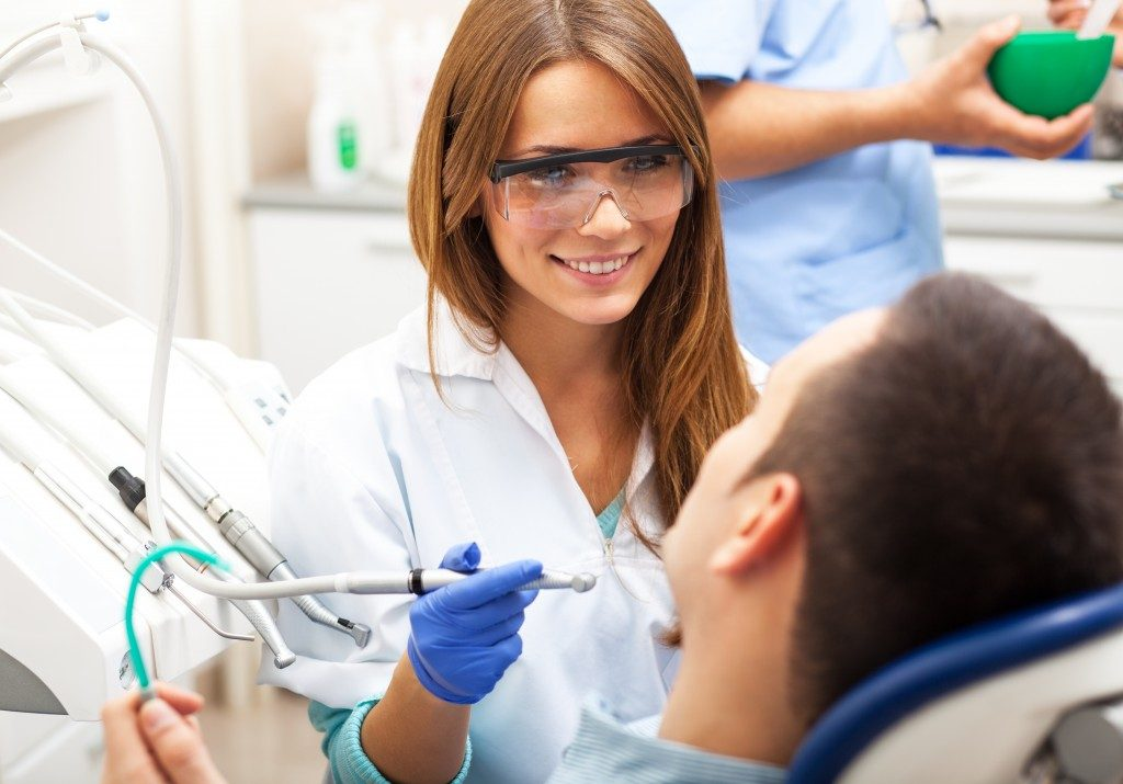 dentist talking to patient