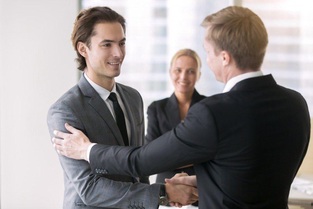 Manager congratulating his subordinate
