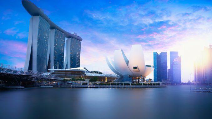 Marina bay Singapore at dusk Singapore city skyline