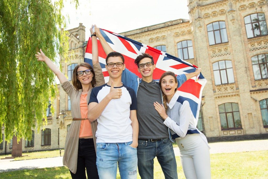 college students with united kingdom flag