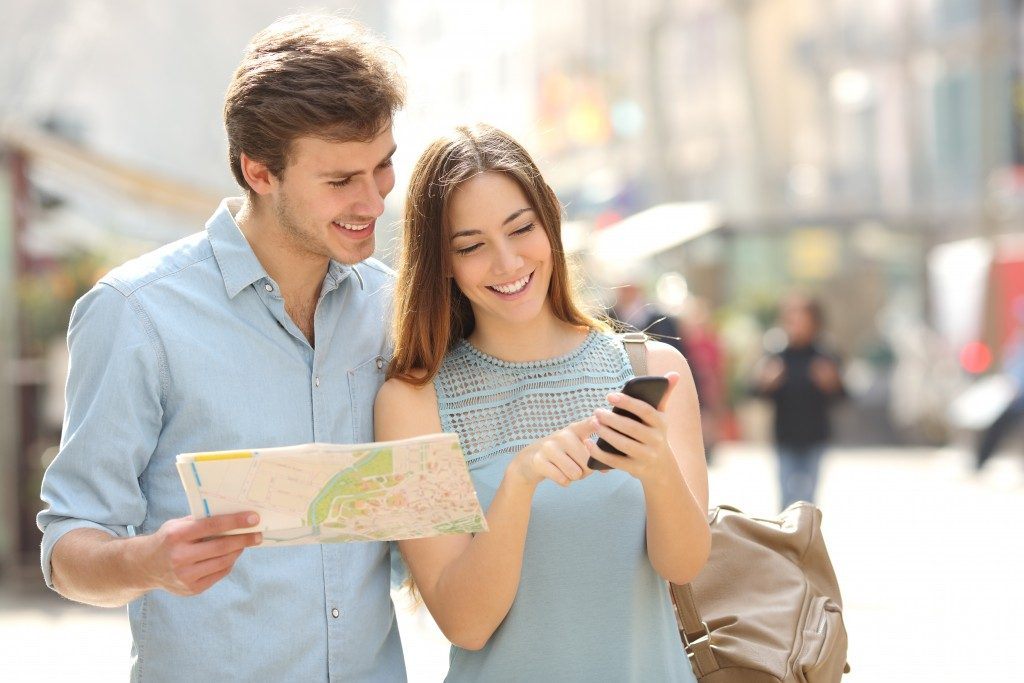 Tourist using smartphone for direction