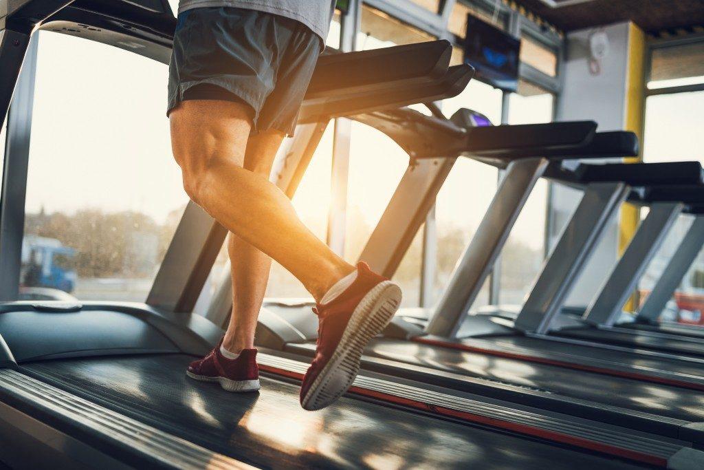 Man running in a treadmill