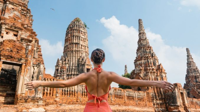 Woman at a temple in Bangkok, Thailand