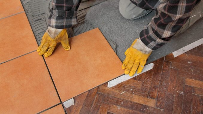 man placing tiles