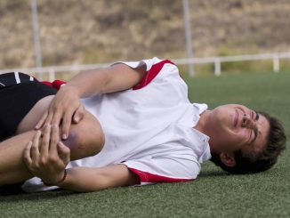 Football player with knee injury