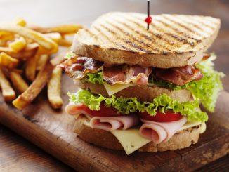 A club sandwich with fries
