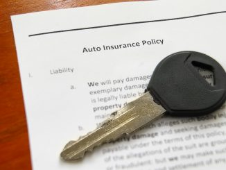 a key for an auto on top of an auto insurance policy