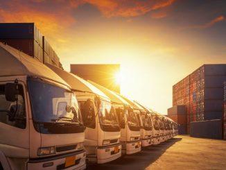 Row of cargo trucks, sunset background