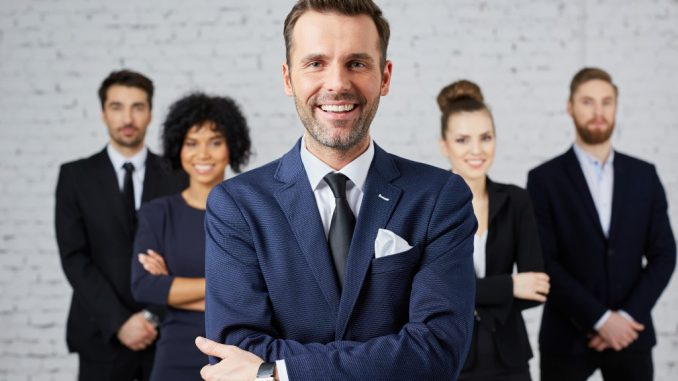 power posing employees dressed in corporate attire