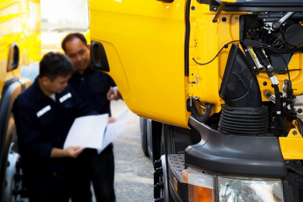 Truck technicians reading the specs of their trucks