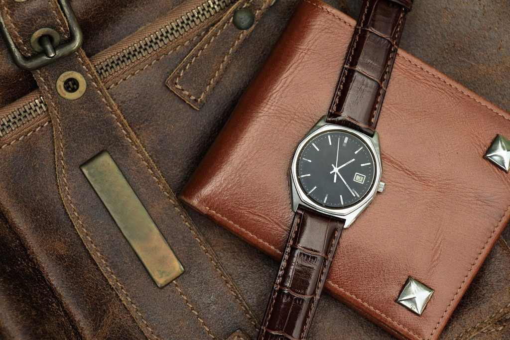Vintage watch on a brown leather wallet