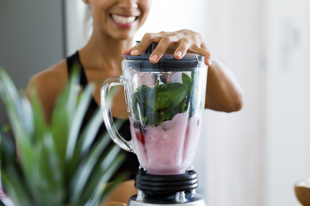 woman using the blender