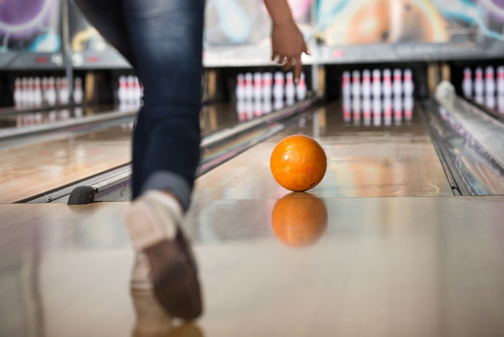 bowling, orange ball rolling
