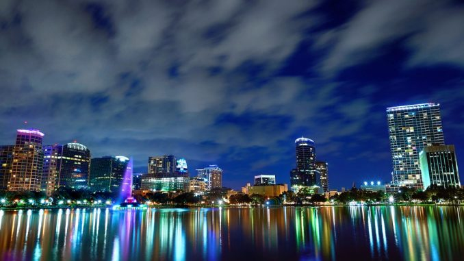 city lights reflecting on the lake at night
