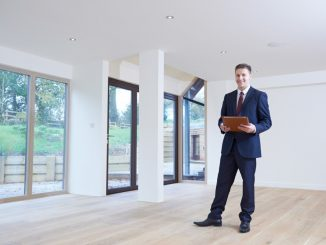 real estate agent inside empty modern house