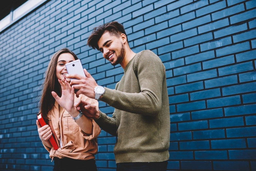 woman and man looking at phone screen