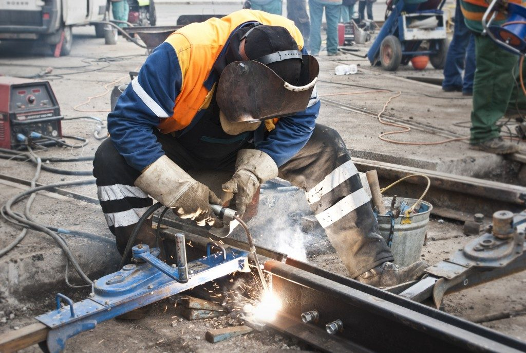 Worker wearing a protective mask while welding