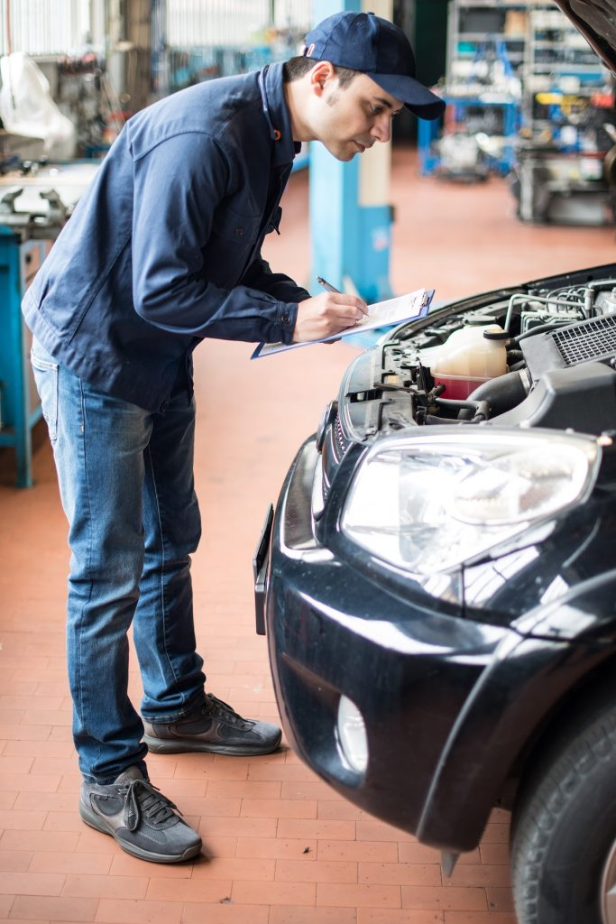 Mechanic checking the engine