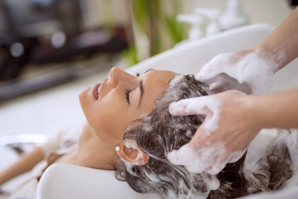 woman having her hair wash in a salon