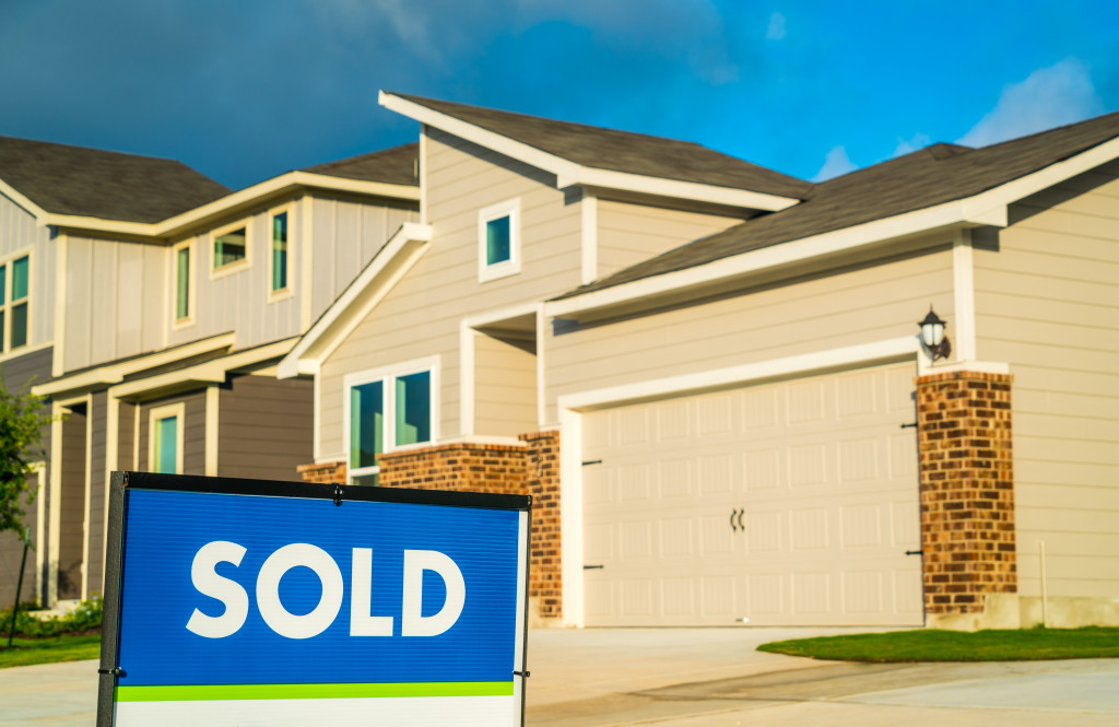 sold signage in front of a home in subdivision