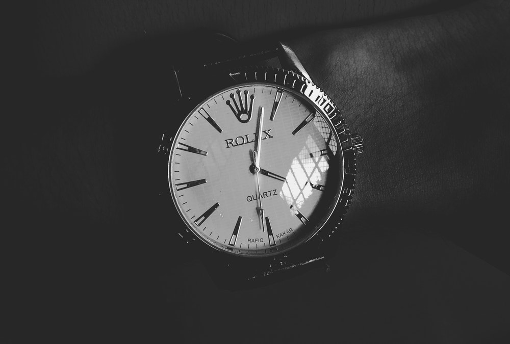 rolex watch in black and white