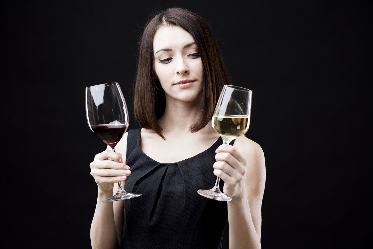 woman thinking of drinking alcohol