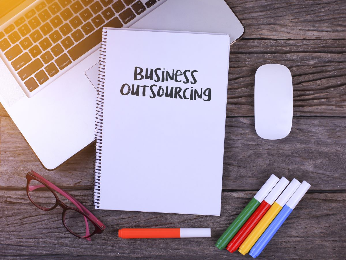 outsourcing written on notebook