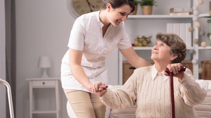 woman assisting elder woman