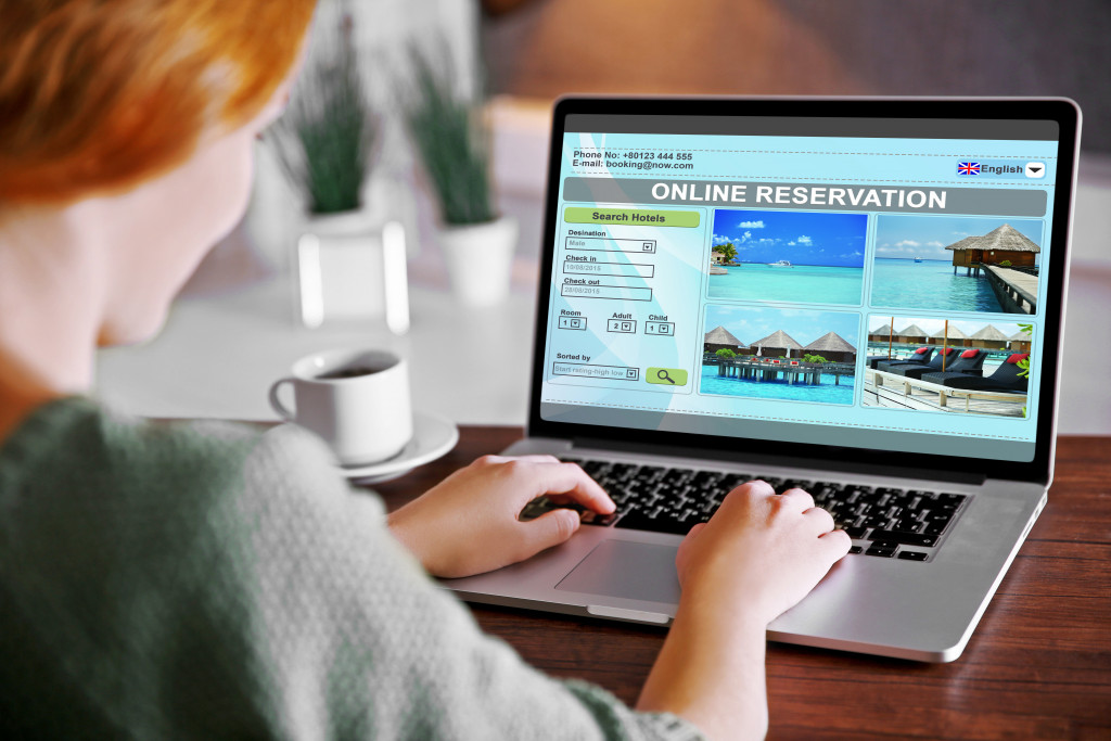 woman booking accommodation online