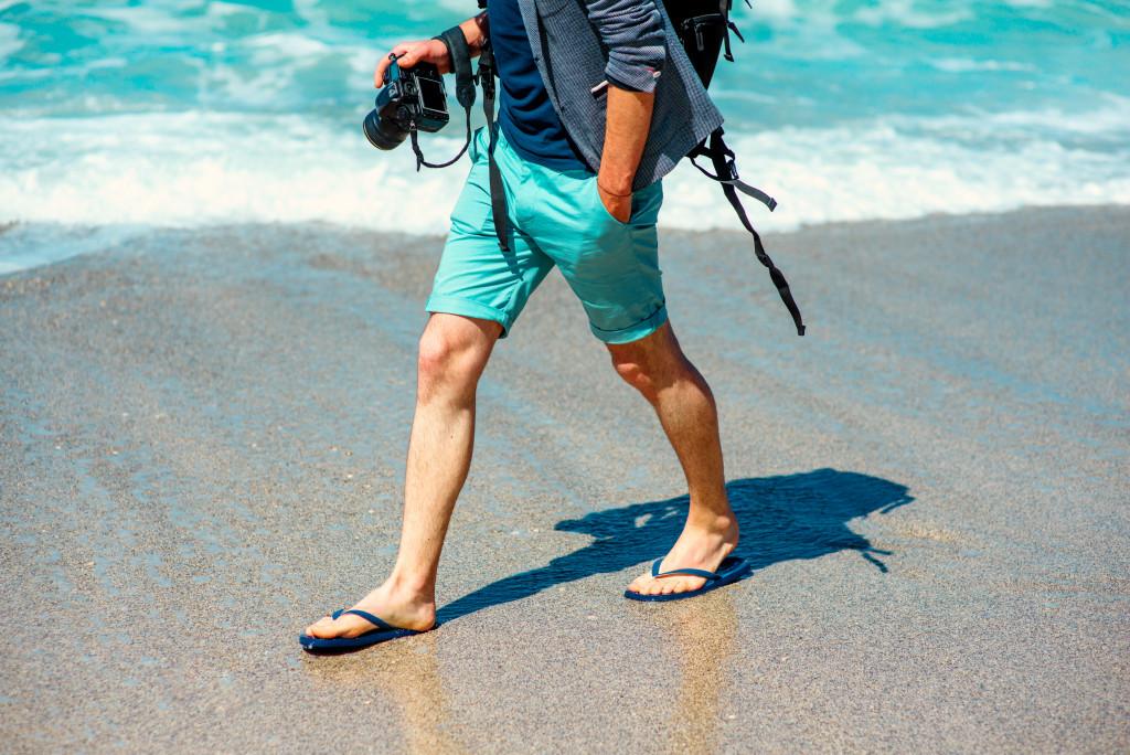 man carrying a camera