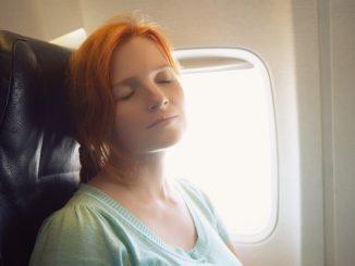woman sleeping on plane